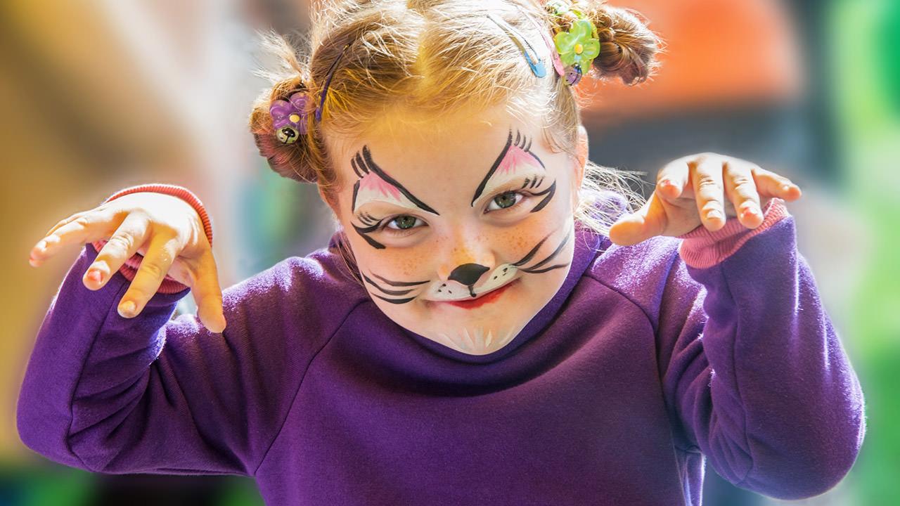 Girl enjoys facepainting at Cliff's Amusement Park